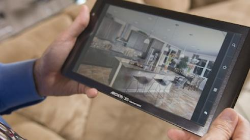 Tablet screen shows a homebuyer using 3D digital models to view homes