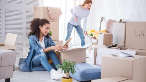 Two girls moving into apartment