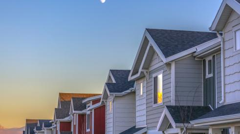 Townhomes with moon in the sky
