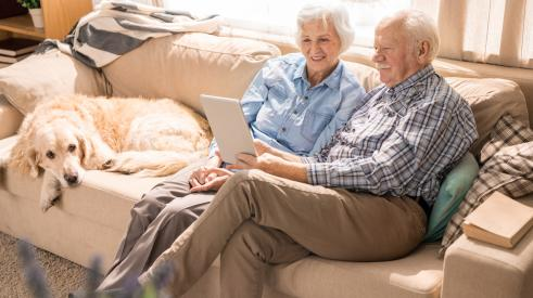 Two old people sitting at home