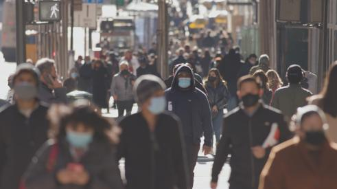People walking in city with masks