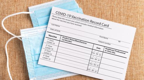 COVID-19 vaccine card and masks