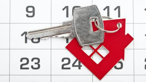 House key with calendar in background