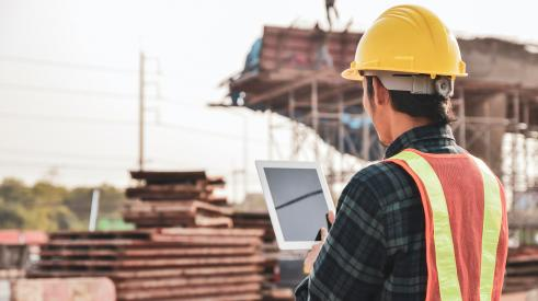 Construction worker with computer tablet