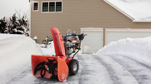 Snow blower in winter weather
