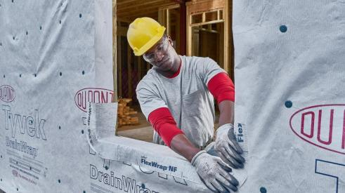 DuPont Tyvek Flexwrap housewrap being installed