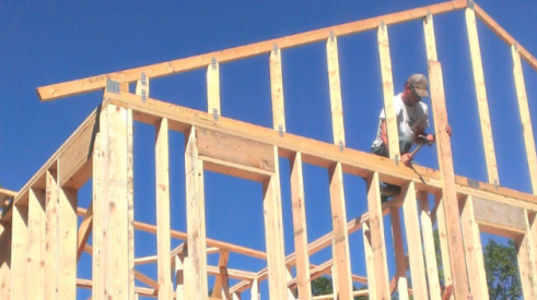 construction worker and timber house framing