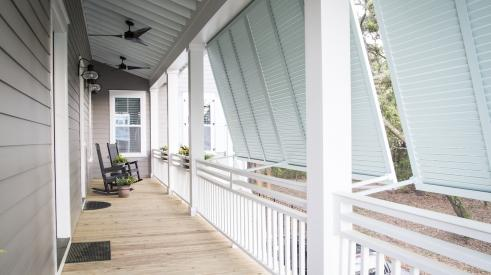 Modern farmhouse-style porch at Creekside at Freeman's Point by FrontDoor Communities, in Charleston, S.C.