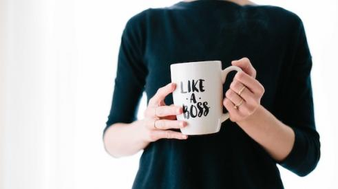Woman_holding_boss_coffee_mug