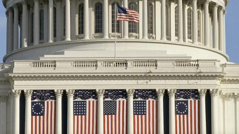 U.S Capitol draped with American flags