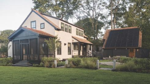 Cottage with solar array on garage in high-performance, net zero house at Jamestown, R.I.
