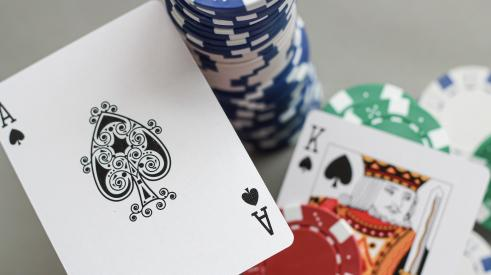 Ace and king cards with poker chips