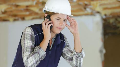 Builder on the phone