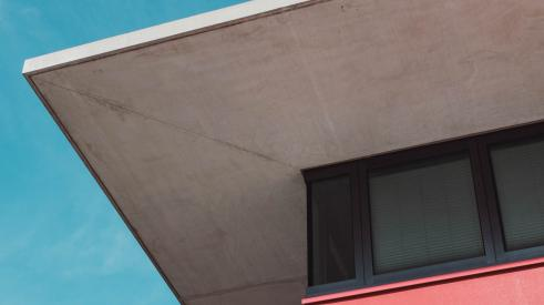 Low-angle shot of home exterior with pink and concrete accents