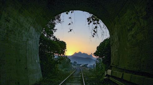 Daybreak at end of dark tunnel signaling a new beginning