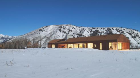 High-performance home exterior of dogtrot barn in Jackson Hole, Wyo.