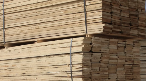Lumber stacked in lumberyard ready for house framing