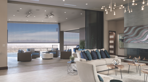 The New American Home 2020 interior with retractable screens opening to views over Las Vegas