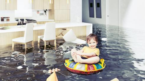 Baby on floaty in a flooded living room