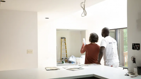Professional painter helping a homeowner select paint colors for the home