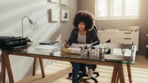 Woman working at desk in home office