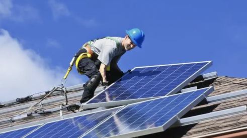 Solar energy mandates mean more work installing solar panels on rooftops
