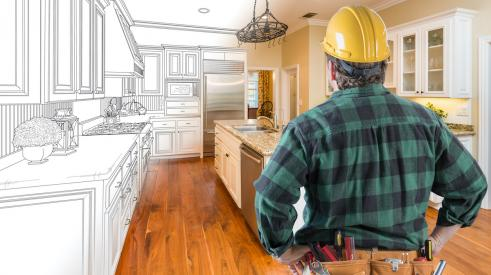 Home builder looking at actual and virtual kitchen