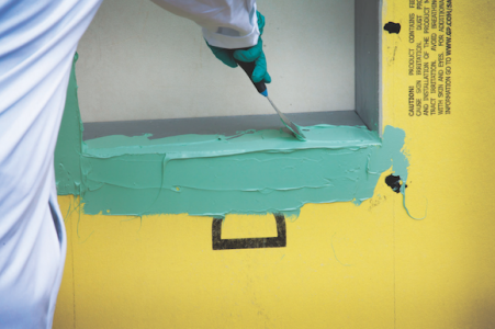 Dow Corning 778 Silicone Liquid Flashing being applied to a window opening.