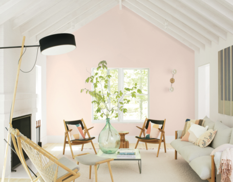 living room painted Benjamin Moore's Color of the Year, First Light, a light-pink hue